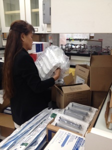 Dr. Julieta Gabiola packing medical supplies to take to the Philippines.