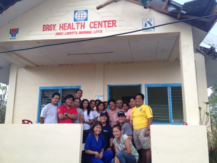 Dr. Gabiola and Brandon Bond with Filipino staff at Mayorga Barangy Heatlh Center