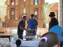 Ian Brown, M.D. and Rob Montana, M.D. of IMC prepare to see patients in the lobby of a church in Barangay La Paz